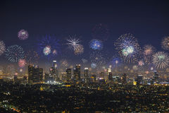 Downtown Los Angeles Cityscape with exploding fireworks during New Years Eve Stock Photos