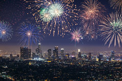 Downtown Los angeles cityscape with fireworks celebrating New Year's Eve. Stock Images