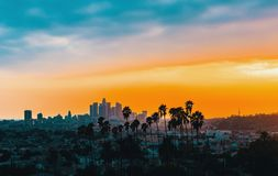 Downtown Los Angeles skyline at sunset. With palm trees in the foreground stock photo