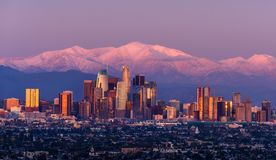 Free Downtown Los Angeles Skyline With Snow Capped Mountains Royalty Free Stock Image - 150541756
