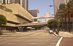 Downtown Los Angeles Street. This is a picture of a downtown Los Angeles street, South Flower Street,  with skyscapers and pedestrian bridges Royalty Free Stock Photos