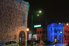 Downtown main street intersection at night holiday lights stock photography