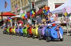 Downtown Mandan ND train barrel kiddie rides. MANDAN, NORTH DAKOTA, July 3, 2016: A Walt Disney decorated kiddie train provides rides at the annual 4th of July Royalty Free Stock Photos
