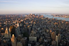 Downtown Manhattan from the Air. Aerial view of Manhattan from 34st looking downtown by very early morning light.  The Brooklyn Bridge, Verrazano Bridge, Statue Stock Image