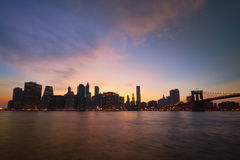 Downtown Manhattan and Brooklyn Bridge at sunset Stock Images