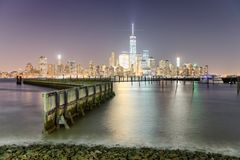 Downtown Manhattan at night as seen from Jersey City Stock Images
