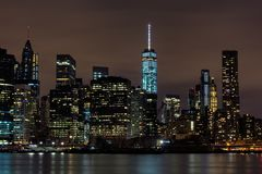Downtown Manhattan night view from Brooklyn Bridge park stock image