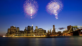 Downtown Manhattan skyline with dramatic fireworks stock photo