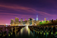 Downtown Manhattan skyline at night from across East River in Br Stock Photo
