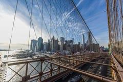 Downtown Manhattan at sunset from Brooklyn Bridge stock image
