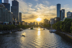 Downtown Melbourne across the Yarra river at sunset Stock Photos