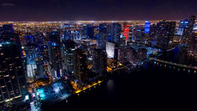 Downtown Miami Aerial Night Skyline. With beautiful reflection of the water in the bay Stock Photo