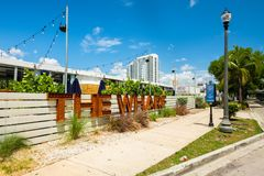 Downtown Miami Cityscape. Miami, Florida USA - July 9, 2018: Scenic downtown Miami cityscape along the Miami River with the popular Wharf, a pop-up event space stock photography