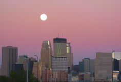 Downtown Minneapolis Dusk Moon. A full moon hovering over downtown Minneapolis during dusk Royalty Free Stock Photos