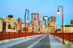Downtown Minneapolis, Minnesota at night time. As seen from the famous stone arch bridge Royalty Free Stock Photo