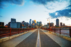Downtown Minneapolis, Minnesota at night time. As seen from the famous stone arch bridge Royalty Free Stock Photography