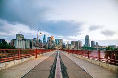 Downtown Minneapolis as seen from the Stone arch bridge. Downtown Minneapolis, Minnesota at night time as seen from the famous stone arch bridge royalty free stock photography