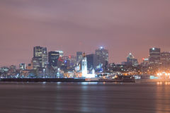 Downtown Montreal skyline at night. Long exposure night scene of the skyline of Montreal, Quebec, Canada, from across the Saint Lawrence river Stock Image