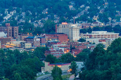Downtown Morgantown and West Virginia University. The campus of West Virginia University, known as WVU, and downtown Morgantown, West Virginia from above at dusk royalty free stock photos