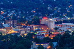 Downtown Morgantown and West Virginia University. The campus of West Virginia University, known as WVU, and downtown Morgantown, West Virginia from above at dusk stock photography