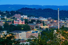 Downtown Morgantown and West Virginia University. The campus of West Virginia University, known as WVU, and downtown Morgantown, West Virginia from above at dusk stock photo