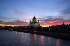 Downtown Moscow in the evening. View of the main church cathedral of Russia, Cathedral of Christ the Saviour and Moskva River. Waterway of the capital of stock photo