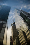 Downtown New York city. Low angle view of modern skyscrapers with cloudscape background in downtown New York city, U.S.A Stock Image