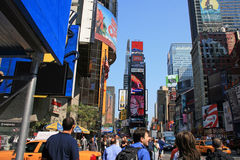 Downtown New York City Times Square. Downtown New York City with Times Square in background and public walking on sidewalk royalty free stock photos