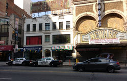 Downtown Newark New Jersey, Newark Police Cars, Historic Paramount Theater Marquee, Newark, NJ, USA. This photo captures Newark of yesterday and today. The still Stock Image