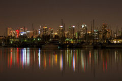 Downtown Night Lights Reflected. City downtown lights reflect into the water Royalty Free Stock Images