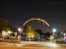 Downtown Oakland Park, Florida shimmers at night during the holiday season. The landmark arch that marks Downtown in Oakland Park, FL USA is decorated for the stock photography