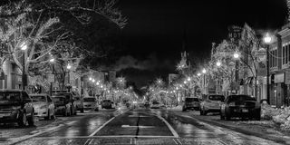 Downtown Oakville Christmas Street Lights B&W. A back and white wintery view of downtown Oakville at night during Christmas time Stock Image