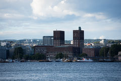 Downtown Oslo. View of Oslo city hall by the busy pier in downtown Oslo Stock Photos