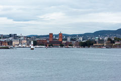 Downtown Oslo. View of Oslo city hall by the busy pier in downtown Oslo Royalty Free Stock Photos