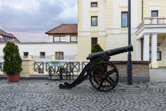 Downtown pedestrian street with a cannon near castle Stock Photo