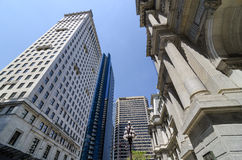 Downtown Philadelphia's Skyscrapers. Standing just outside of Philadelphia's City Hall one catches view of the surrounding buildings and skyscrapers Royalty Free Stock Image