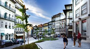 Downtown Plaza in the historic center of the city, called Dos Loios with tourists visiting it. Porto, Portugal. August 12, 2017: Downtown Plaza in the historic royalty free stock photo