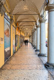 Downtown porch in Bologna. Bologna, Italy - December 27, 2015: day view of Bologna's passage way. In total, there are about 38 kilometres of arcades in the city' Royalty Free Stock Photo