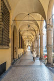 Downtown porch in Bologna. Bologna, Italy - December 27, 2015: day view of Bologna's passage way. In total, there are about 38 kilometres of arcades in the city' Stock Image