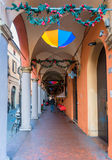 Downtown porch in Bologna. Bologna, Italy - December 27, 2015: day view of Bologna's passage way. In total, there are about 38 kilometres of arcades in the city' Stock Photos