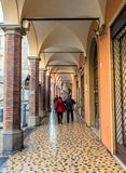 Downtown porch in Bologna. Bologna, Italy - December 27, 2015: day view of Bologna's passage way. In total, there are about 38 kilometres of arcades in the city' Royalty Free Stock Image