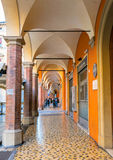 Downtown porch in Bologna. Bologna, Italy - December 27, 2015: day view of Bologna's passage way. In total, there are about 38 kilometres of arcades in the city' Royalty Free Stock Photos