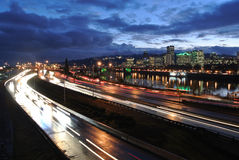 Downtown Portland at Night. A nighttime view of downtown Portland, with traffic streaming along in the foreground Royalty Free Stock Photography