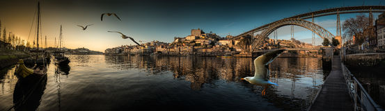 Downtown Porto seen from the river Douro at sunset Stock Images
