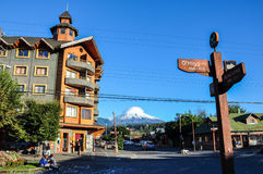Downtown Pucon with Villarrica Volcano, Pucon, Chile stock photo