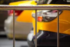 Downtown Rain-wet Handrail. Raindrops at a handrail and yellow car detail at the background stock photo