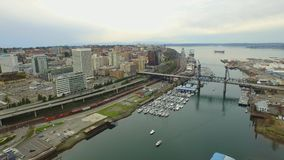 Downtown river view with boats and ships, offices and traffic movement stock video