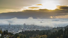 Downtown rolling fog around buildings with rising sun. And high clouds time lapse stock footage