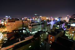 Downtown Saigon by night. Downtown view from roof over the skyline of Ho Chi Minh City (Saigon royalty free stock photos