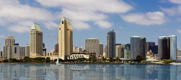Downtown San Diego Seaside Cityscape. Downtown San Diego waterfront cityscape panorama on a late summer afternoon with reflections of the city in the bay waters Royalty Free Stock Photos